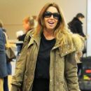 Rachel Uchitel Jets out of JFK - 454 x 726