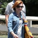 Couple Alyson Hannigan and Alexis Denisof spend some time together at a park in Brentwood, California on July 17, 2015 - 424 x 600