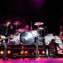 Cinderella guitarist Jeff LaBar, drummer Fred Coury and frontman Tom Keifer perform as the band opens for the Scorpions at the Thomas & Mack Center August 3, 2010 in Las Vegas, Nevada.
