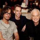 Chris Cornell, Matt Cameron and Jimmy Page pose at a private reception and dinner for Jimmy Page to celebrate his new autobiography