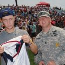 Scotty McCreery participated in the City of Hope Celebrity Softball Challenge today, June 9, at Greer Stadium in Nashville - 454 x 331