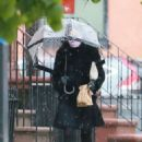 Famke Janssen – Out and about in rainy day