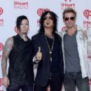 Musicians DJ Ashba, Nikki Sixx and James Michael of Sixx:A.M. attend the 2014 iHeartRadio Music Festival at the MGM Grand Garden Arena on September 19, 2014 in Las Vegas, Nevada - 454 x 336