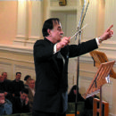 Quandour conducting one of his compositions at the Tchaikpvsky Concert Hall in moscow 2005 - 454 x 418