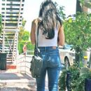 Aimee Garcia in a white tank top and denim jeans at Fred Segal in West Hollywood - 454 x 727