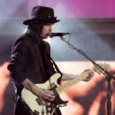 Mick Mars performs onstage at the 2004 Spike TV Video Game Awards at Barker Hanger on December 14, 2004 in Santa Monica, California