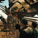 """(Left to right) Sam Witwicky (Shia LaBeouf) speaks with the Autobot® Jetfire as his cohorts Mikaela Banes (Megan Fox), Agent Simmons (John Turturro) and Leo (Ramon Rodriguez) look on in """"Transformers: Revenge of the Fallen."""" Photo Credit: Cour"""