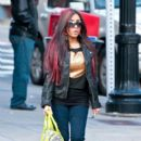 pregnant Nicole 'Snooki' Polizzi quickly flashes and then hides a diamond engagement ring while out walking her dog with Jenni 'JWoww' Farley