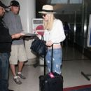 Dakota Fanning was seen arriving at Los Angeles International Airport yesterday, May 8. She flew in from New York City where she was attending university