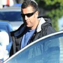 Adam Sandler takes his daughters Sadie and Sunny out for lunch in Brentwood, California on December 29, 2014 - 411 x 594