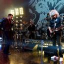 Singer Adam Lambert and musician Brian May perform onstage during Queen + Adam Lambert for iHeartRadio Live at the iHeartRadio Theater on June 16, 2014 in Burbank, California