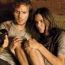 "Michael Stahl-David (left) and Odette Yustman (right) star in ""Cloverfield."" Photo Credit: Sam Emerson. © 2007 by Paramount Pictures. All Rights Reserved."