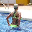 Kerry Katona – Wear Neon Yellow Bikini in Dubai - 454 x 363