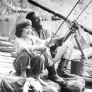 Titles: The Adventures of Huck Finn People: Elijah Wood, Courtney B. Vance - 454 x 612