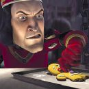 Lord Farquaad (John Lithgow) tries to extract information from the hapless Gingerbread Man (Conrad Vernon) in Dreamworks' Shrek - 2001