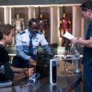"Left to right: Robert Downey Jr. (as Tony Stark), Don Cheadle (as Col. James ""Rhodey"" Rhodes) and director / executive producer Jon Favreau discuss a scene on the set of ""Iron Man 2."" Photo credit: Merrick Morton. © 2010 MVLFFLLC."