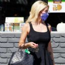 Holly Madison looks cute in black mini dress as she running errands