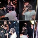 Niall Horan & rumored model girlfriend Barbara Palvin drink beers backstage at the X-Factor Finale