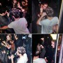Niall Horan & rumored model girlfriend Barbara Palvin drink beers backstage at the X-Factor Finale