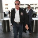Arnold Schwarzenegger departing on a flight at LAX airport in Los Angeles, California on February 3, 2015