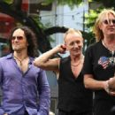 Joe Elliott, Phil Collen and Vivian Campbell of Def Leppard appear for a performance and interview with Mario Lopez of 'Extra' at The Grove, California on June 1st, 2012