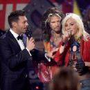 "Host Ryan Seacrest, singer/songwriter Steven Tyler, and finalist Jax speak onstage during ""American Idol"" XIV Grand Finale at Dolby Theatre on May 13, 2015 in Hollywood, California."