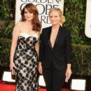 Tina Fey and Amy Poehler arrive at the 70th Annual Golden Globe Awards held at The Beverly Hilton Hotel in Beverly Hills, Calif., on January 13, 2013 - 404 x 600