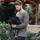 Patrick Schwarzenegger out for lunch with a friend at the Bouchon restaurant in Beverly Hills, California on December 17, 2014 - 420 x 594
