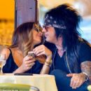 Former hellraiser Nikki Sixx enjoys romantic display with pregnant Courtney Bingham... as first wife Brandi Brandt is jailed for conspiracy to supply cocaine