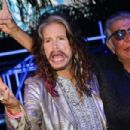 Steven Tyler and Roberto Cavalli attend the Roberto Cavalli show during the Milan Menswear Fashion Week Spring Summer 2015 on June 24, 2014 in Milan, Italy - 454 x 303