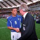 Brazil's Ronaldo shakes hands with England coach Sven Goran Eriksson