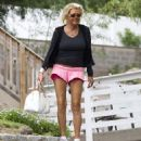 Standing out: Patricia Krentcil, known as Tanning Mom after she allegedly took her five-year-old daughter to a tanning booth, is seen outside her home on Monday - flashing her lacy pink underwear - 454 x 498