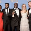 (L-R) Actors Lupita Nyong'o and Chiwetel Ejiofor, director Steve McQueen, actors Sarah Paulson and Michael Fassbender, winners of Best Motion Picture - Drama for '12 Years a Slave,' pose in the press room during the 71st Annual Golden Globe Awards held at - 454 x 302