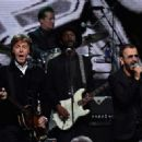 Paul McCartney  and inductee Ringo Starr perform onstage during the 30th Annual Rock And Roll Hall Of Fame Induction Ceremony at Public Hall on April 18, 2015 in Cleveland, Ohio. - 454 x 328
