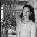 Gong Li as Zhou Yu in Zhou Yu's Train - 2004