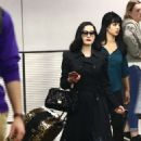 Dita Von Teese – Arrives at the airport in Miami - 454 x 649
