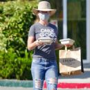 Kendra Wilkinson – Wears an Only Good Vibes T-Shirt at Erewhon Market in Calabasas - 454 x 681