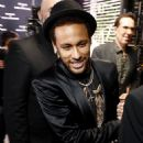 Neymar smoulders in a sleek black blazer, matching shorts and a gold-embellished shirt as he launches new Diesel fragrance - 454 x 623