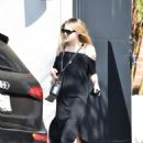 Dakota Fanning in Black Dress at Nine Zero One salon in West Hollywood