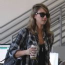 Jessica Alba has her hands full as she arrives to an office building in Los Angeles
