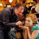 KEVIN LIMA and AMY ADAMS on the set of ENCHANTED ©Disney Enterprises, Inc. All rights reserved. Photo Credit: BARRY WETCHER/SMPSP