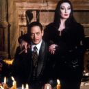 Anjelica Huston and Raul Julia