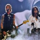 Musician Duff McKagan and singer Alice Cooper of Hollywood Vampires perform onstage during The 58th GRAMMY Awards at Staples Center on February 15, 2016 in Los Angeles, California. - 454 x 302