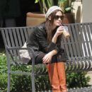 Emmy Rossum - Rests Before Picking Up An IPhone At The Grove In L.A. - September 9, 2010