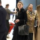 Amber Heard – Arrives at Charles de Gaulle Airport in Paris