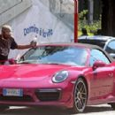 Michelle Hunziker – Spotted at her pink porsche in Milan - 454 x 296
