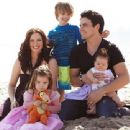 Chyler Leigh and Nathan West with their kids on the beach