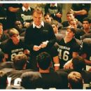 The Permian team gathers around Coach Gaines (Billy Bob Thornton) in the Astrodome locker room.