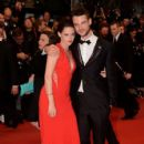 Kristen Stewart & Tom Sturridge at Rob's Cosmopolis Premiere - 426 x 640