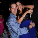 Sofia Vergara sits on fiance Nick Loeb's lap during New Year's Eve celebrations at Miami's Delano on Dec. 31, 2012